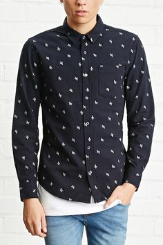 A slim-fit woven shirt with an allover cactus print, a basic collar, a buttoned front, a chest patch pocket, and button-cuff long sleeves.