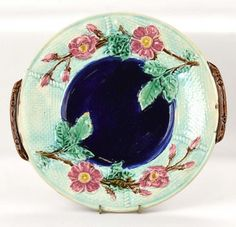 Majolica wild rose and robe round tray with cobalt : Lot 559