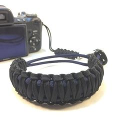 Black and Midnight Blue DSLR Camera safety strap. Easy to wear, tangle free, super strong, and very light. Want one in your favorite colors, or team colors? Hit me up. #papabearshouse #stupidstraps #etsy #etsyshop #etsyseller #straps #camerastrap #strap #camera #550 #strong #cameragear #dslr #safetystrap #safety #photography #custom #handmade #nikon #madetoorder #canon #sony #photographer #black #midnight #blue #midnightblue