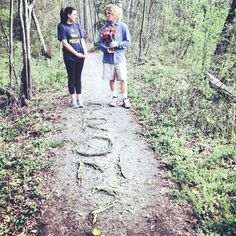 Sivan Levy, left, was captivated by Reid Schweers' creativity when he wrote out his prom invitation in flowers during a hike along the Chattahoochee River.