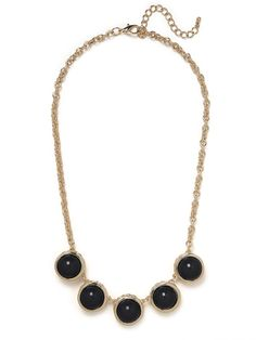 This gorgeous necklace works a supremely posh and sophisticated allure — think Ladies Who (fabulously) Lunch. Its bold, regal and tony in the most chic way.