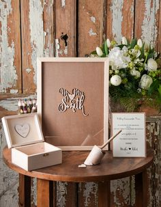 Beautiful alternative for traditional Wedding Guest Books from @4LOVEPolkaDots || Guests fill out wooden hearts and drop into the picture frame || Includes instruction card || #weddingguestbook