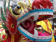 chinese dragon head   Close up of Chinese dragon dancing in Chinatown, London, England