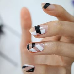 This black and white negative space manicure is amazing