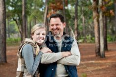 Portrait of father and teen daughter at park stock photo 15485375 ...