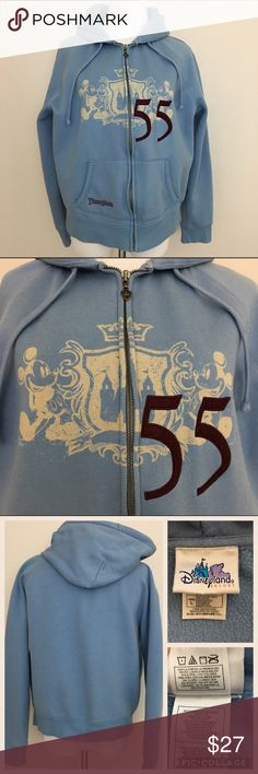 """Disneyland Women's Zipped-up Hoodie, Blue, Large Disneyland Resort Women's Zipped-up Hoodie with drawstring. Frontal pockets. Zipper's pull tab is castle carved. See pic.  Designed as a 55th year anniversary with Mickey Mouse and the disney castle.  Fabric is made of 70% cotton and 30% polyester. Machine washable.  Size Large Armpit to armpit 21"""" Length 23.5"""" Approximate only.  Pre-owned in great condition.  Stored in a smoke and pet free household.  Please see pictures for details or asks…"""