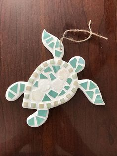 This beautiful stained glass sea turtle would make a wonderful gift for a fellow sea turtle lover! Perfect to use as a Christmas Ornament. This beautifully handcrafted stained glass mosaic sea turtle decoration was made with care. The sea turtle mosaic features hand cut opaque stained