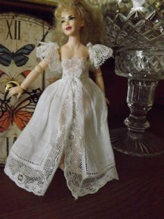 1:12 scale wearable miniature doll clothes on https://www.etsy.com/ca/shop/Miniaturesbyphoebe.  (This item is now sold.). The shop owner is Michelle Dormer.