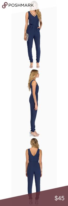 "Navy jumpsuit NEW NEW WITHOUT TAGS.                                                100% Polyester Imported  Color: Black, Olive, Navy Waist: 24""  High point shoulder to waist: 17"" Waist to hem: 41.5"" Inseam: 30"" Front rise: 13"" Back rise: 15"" At the thigh: 22"" At leg opening: 10"" Front pockets Back zipper with hook & eye closure Pants Jumpsuits & Rompers"