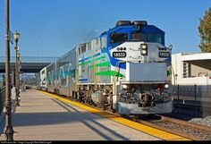 Metrolink 119 departs Camarillo behind a leased F59PH in a colorful livery.