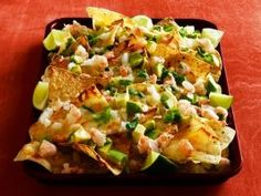 Margarita Shrimp Nachos : Marinate 1/2 pound shrimp in margarita mix with a dash of cayenne; grill. Top lime-flavored tortilla chips with 1 1/2 cups each shredded white cheddar and muenster. Bake, then top with sauteed shrimp, diced onion, avocado, lime juice and cilantro.