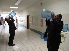 Elder Mulitalo and his cousin (all Polynesians are cousins, as far as I can tell. EVERY Polynesian who has come here, Elder Mulitalo has been related to in some way, or has met or heard of in some way) Elder Purcell, drinking from their water bottles.