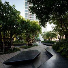 landschaftsbau modernes design sitzbank park asymmertrische linien