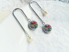 These asymmetric earrings is combination of vintage embroidery art and modern materials. Embroidered charms are made of stainless steel. Hand embroidery is made with natural silk floss, more than 550 stitches in 1 cm2. Floral pattern is vintage (19 century). Colorful embroidery complemented by freshwater pearl charms. The earrings itself made of rhodium plated brass. Vintage Embroidery, Floral Embroidery, Hand Embroidery, Needlework, Jewelry Making, Pearl Earrings, Modern Materials, Pearls, Stitches