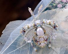 Sparkly Queen Bee jewelry - hand-embroidered Honey Bee pin - beautiful as brooch or hair ornament for the Bride, luxury Gift for Mother of the Bride or Mother of the Groom, perfect gift for your bridesmaids, or excellent as anniversary gift.  Delicate and beautiful hand-embroidered Bee pin for your special day from collection Let Them Eat Cake. Very filigree work.  The Bee is tightly and neatly embroidered on lace and on imitation of leather - embroidery techniques are mixed in this…