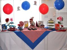Dr. Seuss party table.  I love the punch balloons, it's a fun idea not to mention cheaper than paper lanterns.