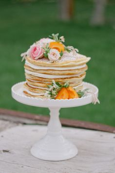 White wedding cake stand with scalloped edge