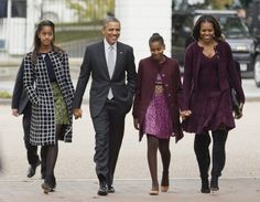 President Barack Obama, second from left, with first lady Michelle Obama, right, and their daughters Malia, left, and Sasha, walk from the White House in Washington to attend a church service on Oct. 27, 2013.  When it became clear to President Barack Obama that Donald Trump would be his successor, he