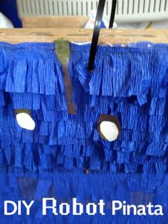 DIY Robot Pinata - perfect for little boy birthdays! We did this with our preschooler's 3rd birthday and he loved it!