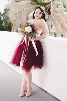 A neutral-colored top paired with an awesome, cranberry-colored tulle skirt.