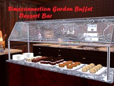 This time I have two buffets for you. I've modified Simsconnection Garden Buffet Dessert Bar. I love desserts and so do my Sim so I've chosen six of their favorites (as you can see one of my Sims is a big fan of the tarts). The first buffet is full...