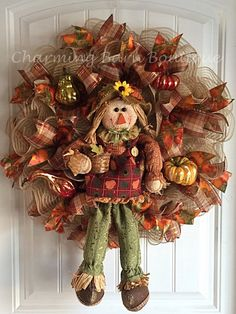 This adorable scarecrow wreath is just too cute and a must have addition for your fall decor. Beautiful scarecrow holding her basket of