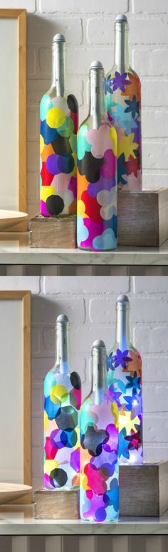 If you love wine bottle crafts, these lanterns are easy to make with tissue paper and Mod Podge. The bottle lights are easy to install and make the project!