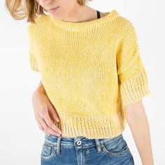 Cropped short sleeved yellow jumper with special knitted details. Perfect as a summer top in warmer days and for layering as the weather cools down.