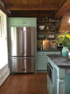 Blue green cabinets / Farmhouse kitchen. Stone House Revival - Season One.