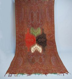 """LOT 196 - whitakerauction  PAISLEY SHAWLS, 19th C. One long paisley, probably French, with """"four seasons"""" center in palmette design. 126 x 62"""