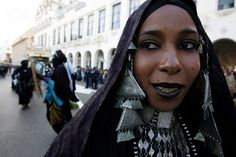 Africa | An Algerian Tuareg woman performs during the inaugural parade marking the City of Algiers as the Arabic cultural capital for 2007 | Photographer unknown, as the link is no longer available for my area.