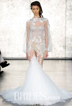 Brides.com: . Style 1614, organza bell sleeve beaded shrug over a silver lace strapless mermaid wedding dress with ivory vine embroidery, Inbal Dror