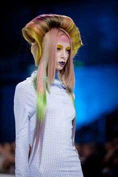 Her hair is so colorful and quirky, but she looks so depressed - mixed message hair.