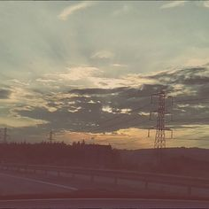 I took this from the front passenger seat of our car - I live the way the sun lights up the clouds.