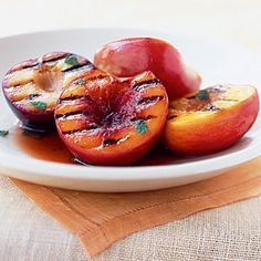 Black pepper and vanilla heighten the sweetness of the stone fruit. Firm fruit holds up best on the grill. Serve this dish as an appetizer or salad course. If you can't find pluots, double up on peaches or plums.