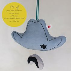 Johnny musical toy (with black print). $40.00, via Etsy.