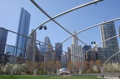 """Millennium Park: This 24.5-acre park features Frank Gehry's Pritzker Pavilion and serpentine bridge; sculptor Anish Kapoor's 110-ton Cloud Gate (a.k.a. """"The Bean""""); and Jaume Plensa's Crown Fountain, with its ever-changing array of locals' faces spewing water very five minutes in the summer months. The Lurie Garden wows with year-round flower displays and monthly garden walks."""