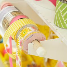 Organize all your favorite spools of ribbon by sliding them onto a dowel held in place by brackets./