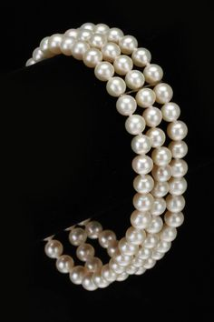 Elegant Pearl Triple Row Bracelet In White.