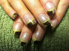 Clear and brown glitter acrylic nails with gold nail art