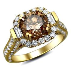 A very unique & stunning Round cut Cognac Diamond Engagement Ring set in 14k Yellow Gold. It features an SI1 clarity 1.32tdw carat Cognac Round Diamond set in the center. Also 2.0tdw carat's of Round & Baguette Diamonds surround the center solitaire. Round Diamonds set on top, sides, front & back of the ring in a pave setting. Baguette cut is set on both sides of center diamond. All diamonds have a grading of VS1-VS2 & color E-F. #unusualengagementrings