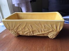 A personal favorite from my Etsy shop https://www.etsy.com/listing/468248012/mccoy-vintage-yellow-ceramic-planter