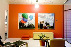 love this orange wall and photo that's split into two pieces!