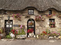 Thatched Cottage | This is one of the many beautiful thatche… | Flickr