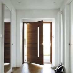 This stunning western, red Cedar, pivoting door creates a real focal point in the hallway. The mechanism means that doors can be made wider than they are tall and still remain sturdy.