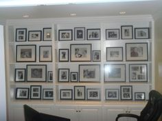Photo Wall modern home office. shelves or ledges above table in dining rm. Put black frame display. Frame Wall Collage, Hanging Picture Frames, Frame Display, Wood Picture Frames, Picture Wall, Display Case, Display Ideas, Framed Art, Bookshelves Built In