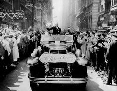 September 3,1936 - JESSE OWENS WELCOME PARADE:    Olympic gold medal winner Jesse Owens waves during a ticker tape parade along Broadway in New York City on Sept. 3, 1936. The twenty-two-year-old won four gold medals at the Summer Olympics in Berlin, Germany.