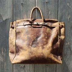 distressed brown leather bag.