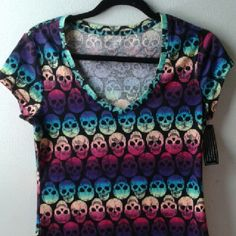 Rainbow Skulls V-neck Shirt Beautifully edgy shirt covered in a bright rainbow gradient of skulls. Size L but kinda small so would also fit medium. Not very stretchy, would not recommend for busty babes. Brand new. No Boundaries Tops Tees - Short Sleeve
