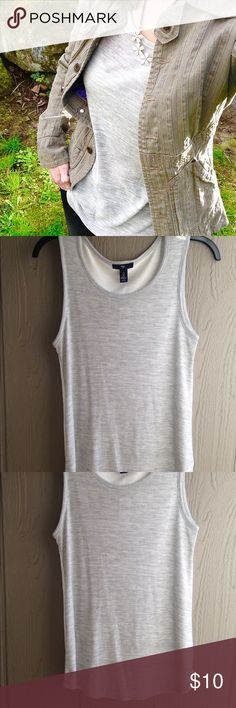 "GAP sleeveless top NWT Gap grey & cream sleeveless top. Scoop neck tank with curved hem. Measures 16.5"" armpit to armpit and 27.5"" from shoulder to longest part of curved hem. Soft polyester & viscose blend. Slightly sheer. GAP Tops Tank Tops"
